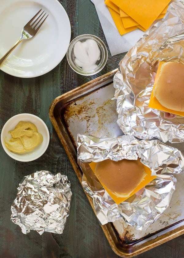 For easy camping food that the entire family will love, try these Ham and Pineapple Sandwiches, cooked in foil packets beside the campfire #camping #campfirefood