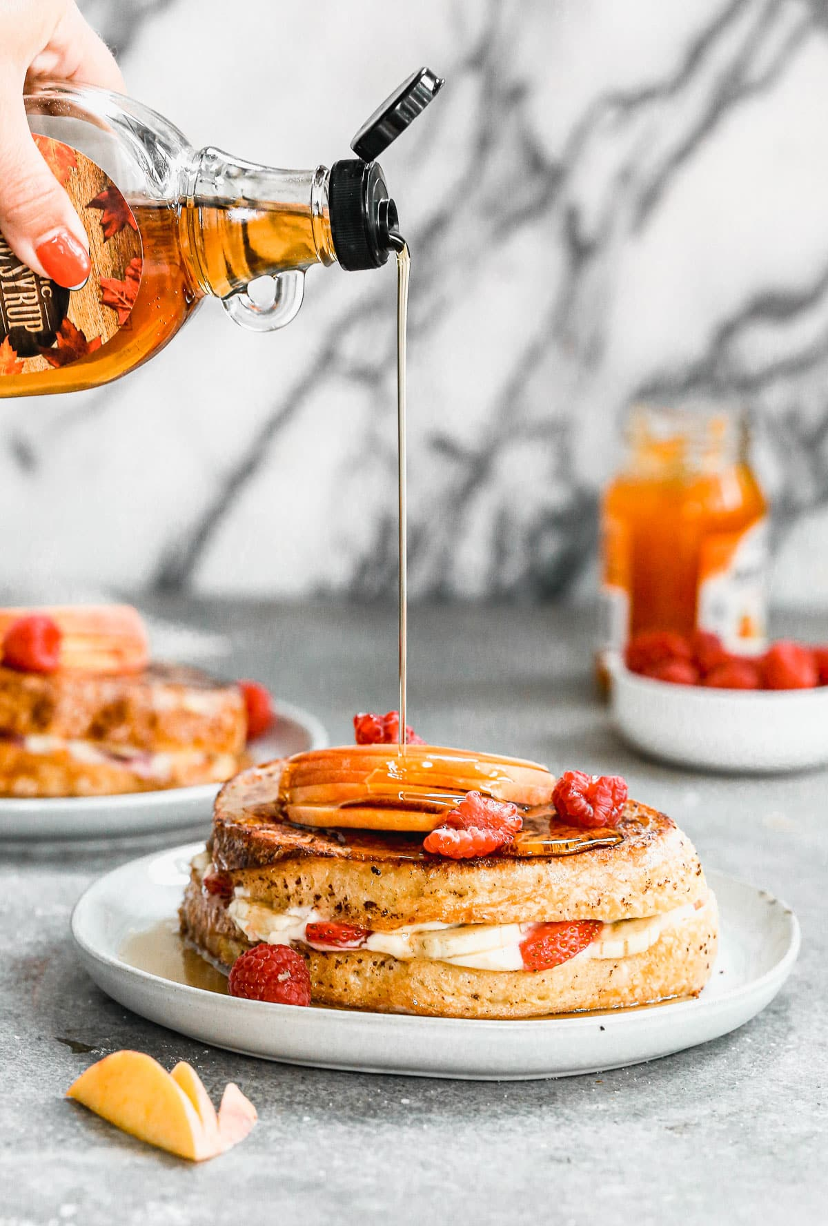 syrup drizzling on stuffed french toast