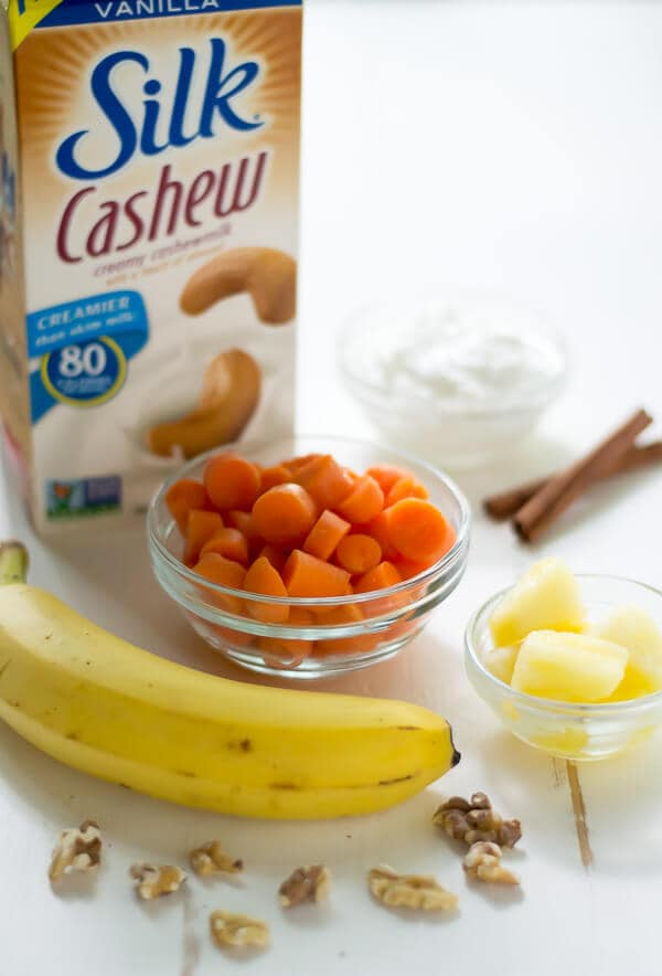 Ingredients for carrot smoothies on a white weathered board