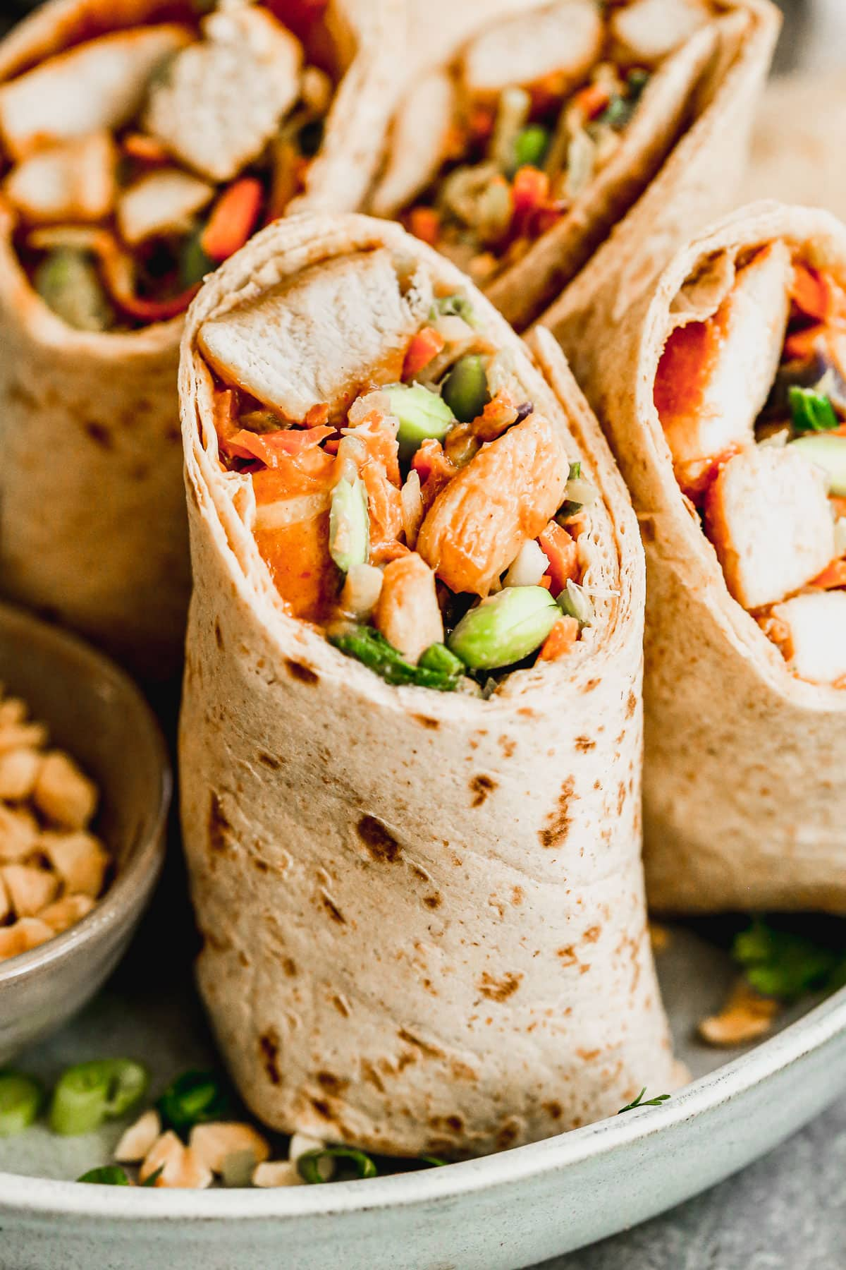close up of healthy asian chicken wraps on a plate