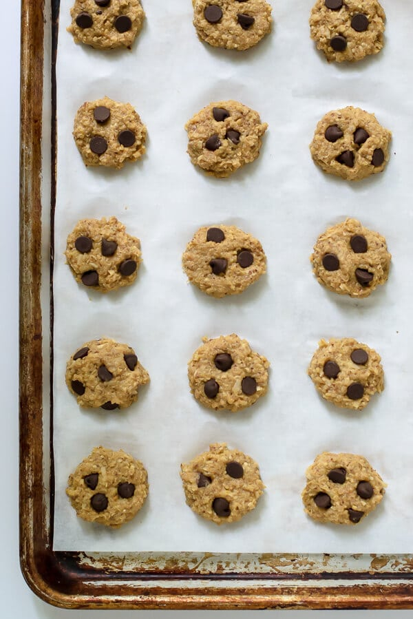 Chocolate Peanut Butter Quinoa Cookies on a parchment-lined baking sheet