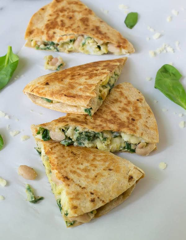 4 breakfast quesadillas filled with spinach, eggs, and cheese