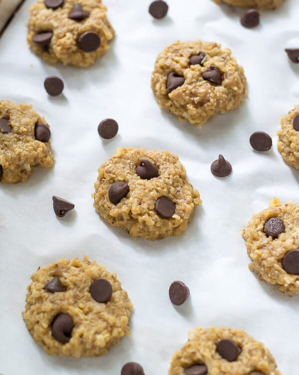 No-Bake Quinoa Cookies made with peanut butter and chocolate chips on parchment paper