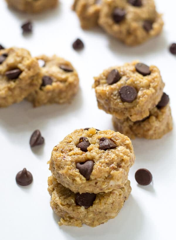 No Bake Peanut Butter Quinoa Cookies stacked on parchment paper