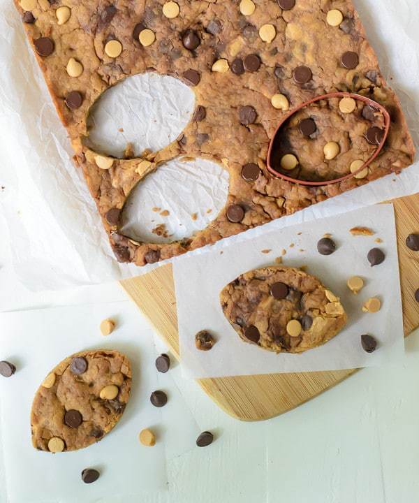 Use cookie cutters to turn this recipe for peanut butter blondies into Football Blondies with chocolate chips!