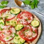 An easy, healthy meal that's ready in 20 minutes- Veggie Pita Pizzas. Kids love this recipe too, and it's great for lunches and after school snacks