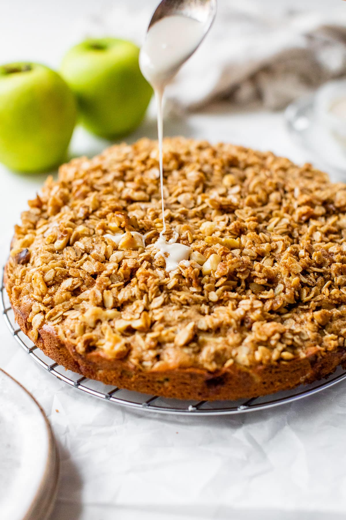 Fresh Apple Coffee Cake with glaze being poured on top