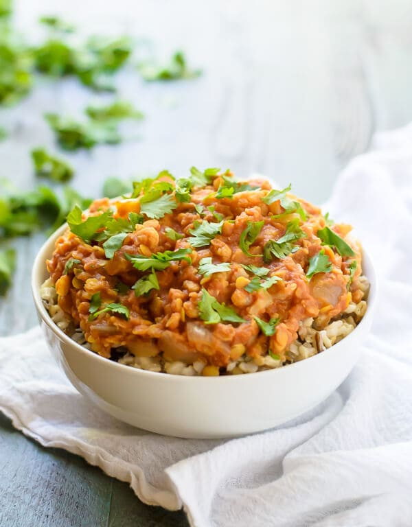 bowl of vegetarian lentil and cauliflower curry, made in a slow cooker with coconut milk