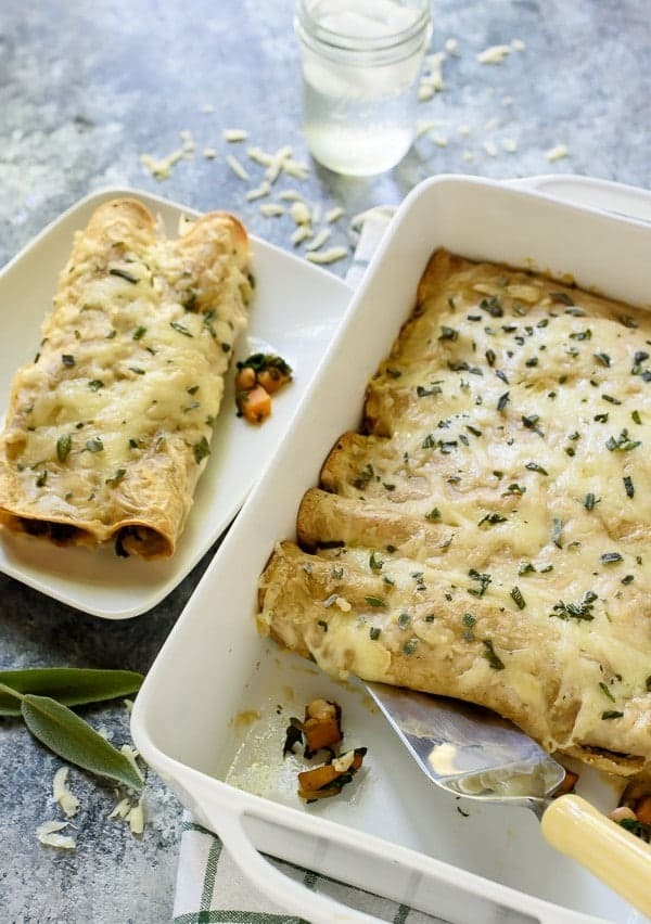 Cheesy Butternut Squash Enchiladas with Spinach and White Beans