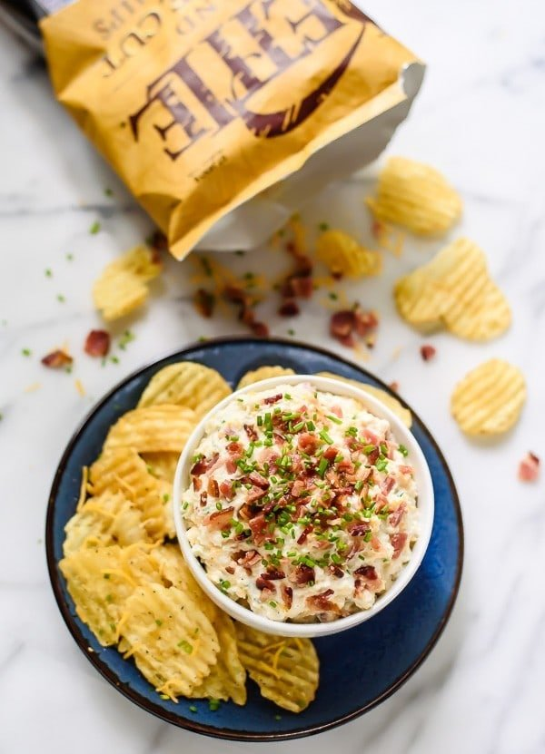 Loaded Baked Potato Dip with Bacon, Sour Cream and Cheese. Everyone's favorite baked potato flavor in dip form! Perfect for football parties, game watches, and tailgating