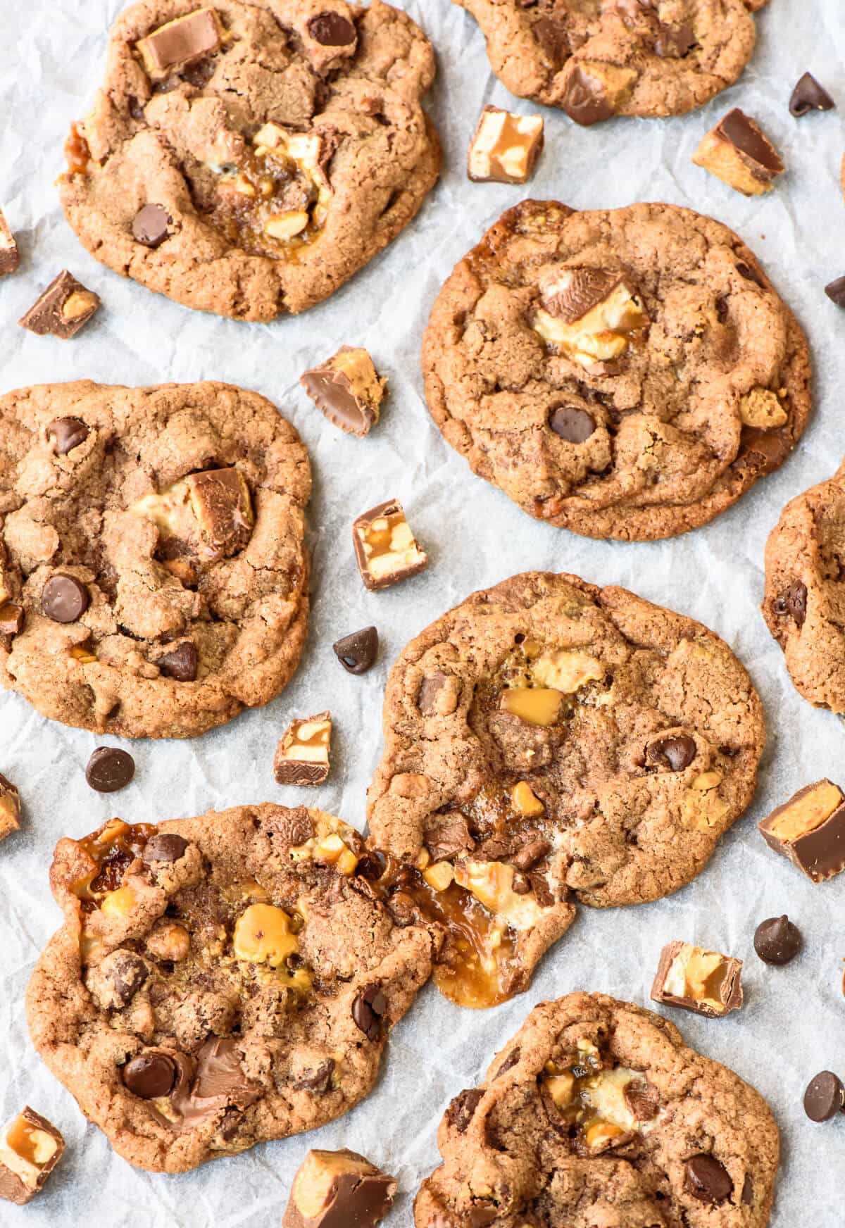 Peanut Butter Snickers Cookies. Soft and chewy with melting puddles of caramel and chocolate. Even better than a candy bar and perfect for using leftover candy too!