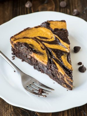 Pumpkin cheesecake meets fudgy brownie in this easy but impressive pumpkin brownies recipe