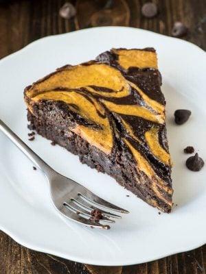 Pumpkin cheesecake meets fudgy brownie in this easy but impressive pumpkin brownies recipe