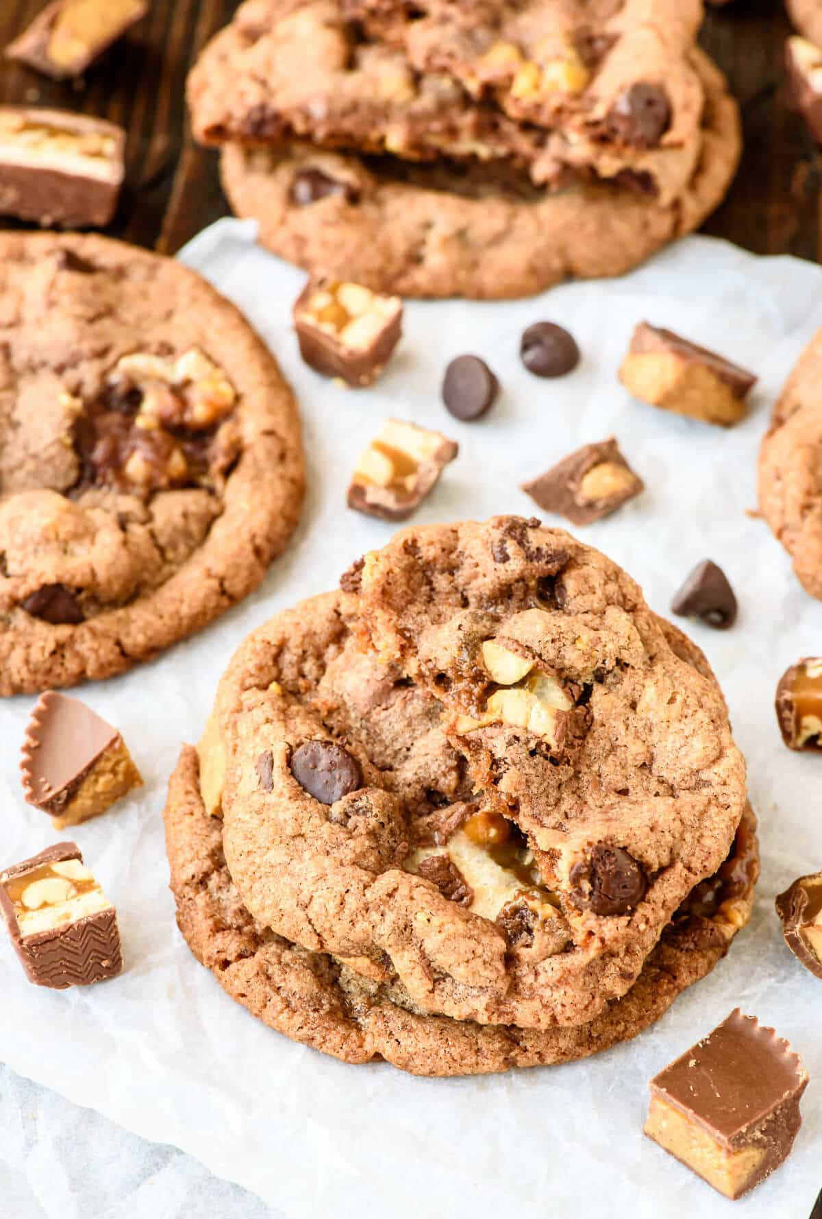 Soft and Chewy Peanut Butter Snickers Cookies. Reeses peanut butter cups and Snickers bars baked into soft, chewy cookies that are loaded with chocoalte chips! Perfect for leftover candy