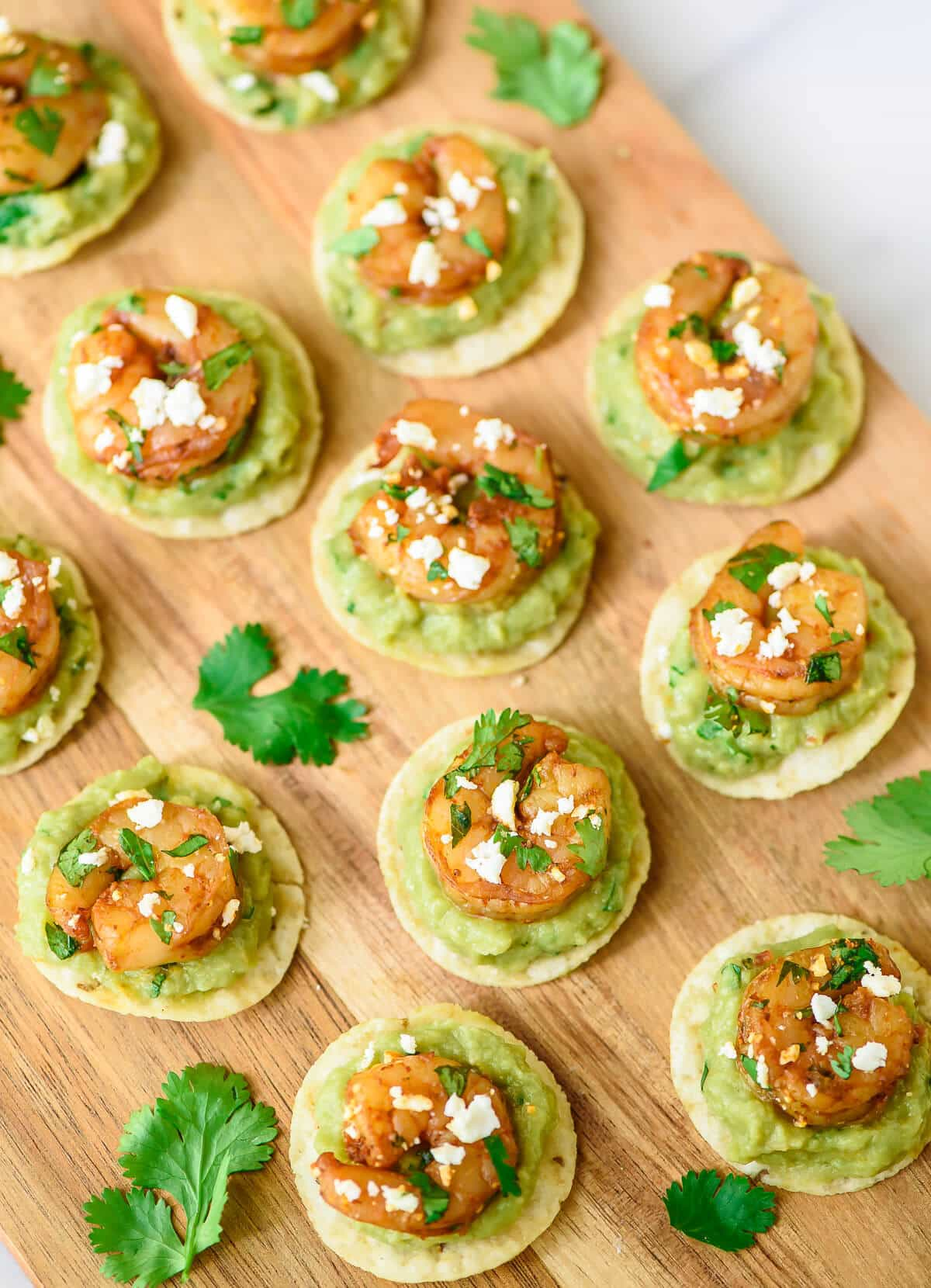Spicy Shrimp Guacamole Bites. Guac on top of tortilla chips with spicy shrimp. A fast and easy appetizer recipe that is so addictive!