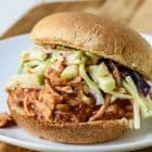 crock pot bbq chicken sandwiches with apple slaw on top