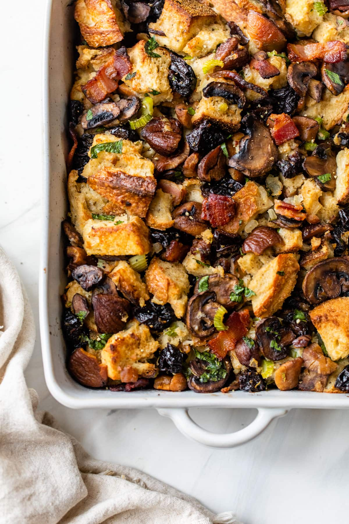 This Bacon Mushroom Stuffing will steal the show at Thanksgiving! Rosemary and dried plums make it extra special