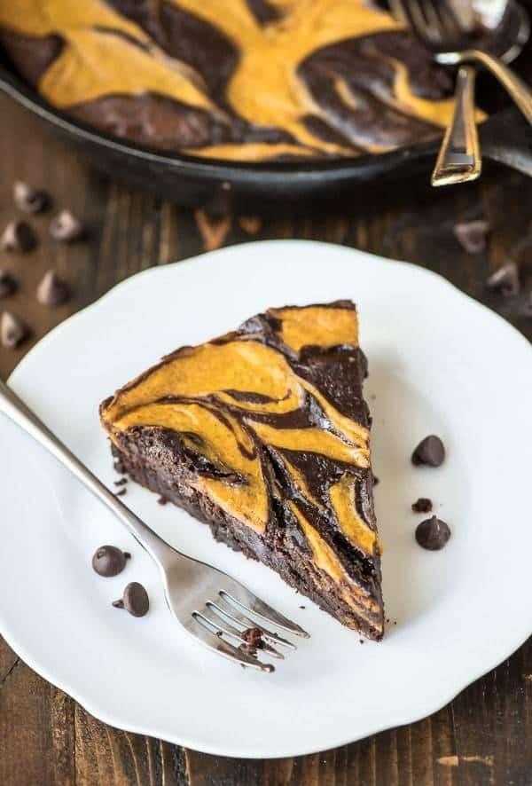 Ultimate Pumpkin Brownies recipe. Pumpkin cheesecake swirled with rich, fudgy brownies. The ulimate pumpkin dessert!