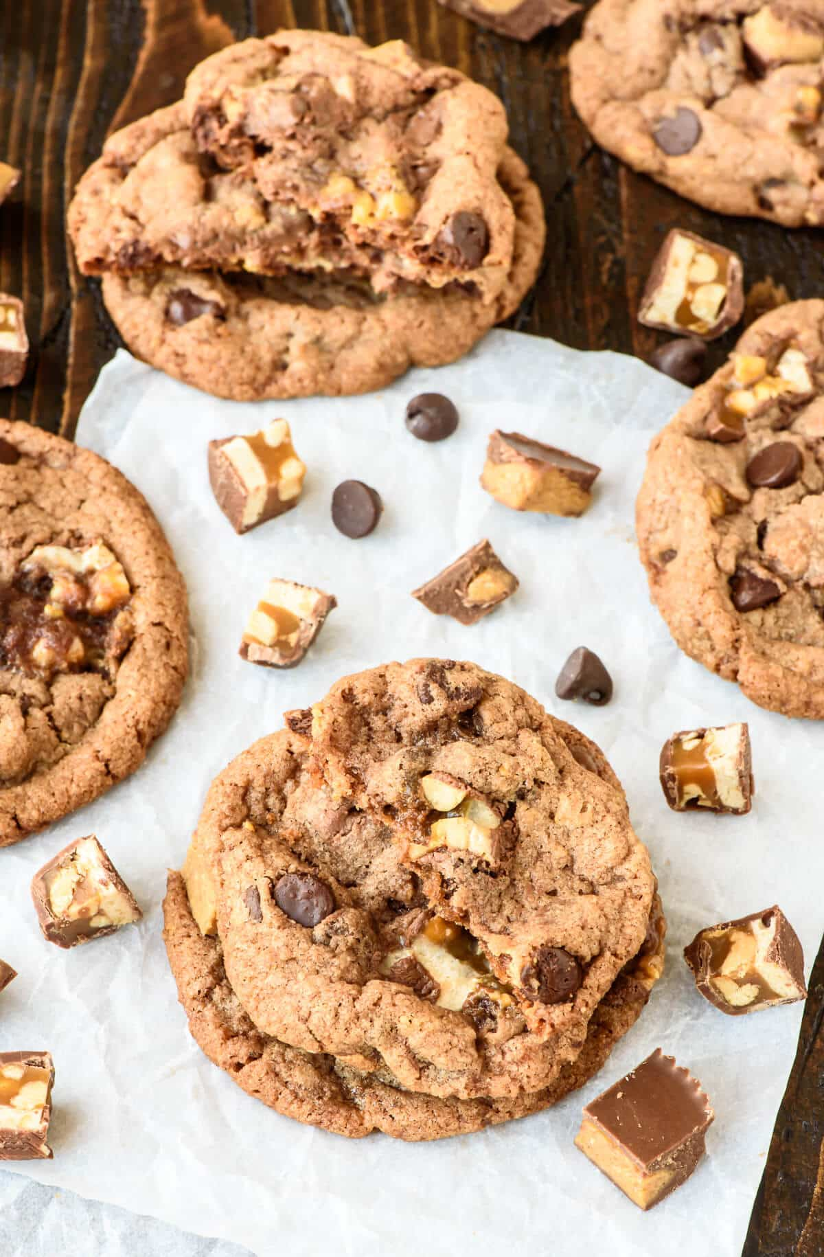 use your leftover candy to make these decadent peanut butter snickers cookies soft chewy
