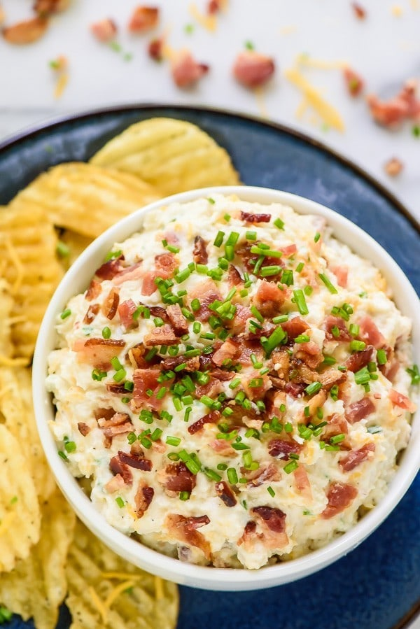 Your new favorite appetizer- Loaded Baked Potato Dip! Made with bacon, sour cream, and cheddar, this has all the flavor of a baked potato, but tastes even better!