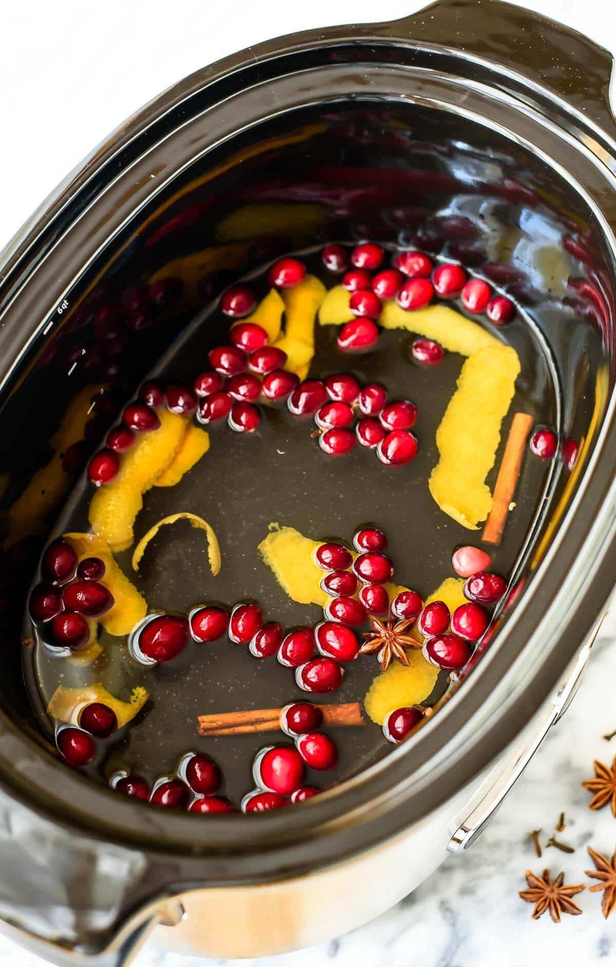 Slow Cooker White Mulled Wine. This is the ultimate holiday party drink recipe! Easy to make in big batches, and everyone will love its holiday flavor.