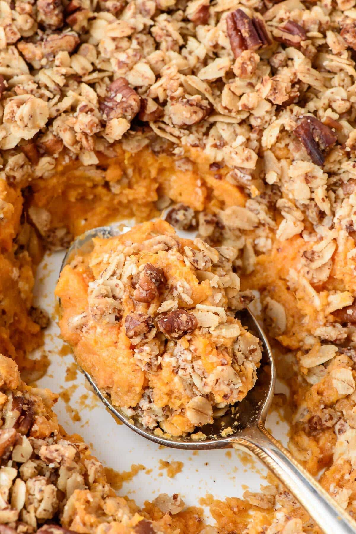 You will never believe this healthy sweet potato casserole is vegan, dairy free and gluten free! Made with coconut oil, maple syrup and vanilla beans with an irresistible pecan oat topping.