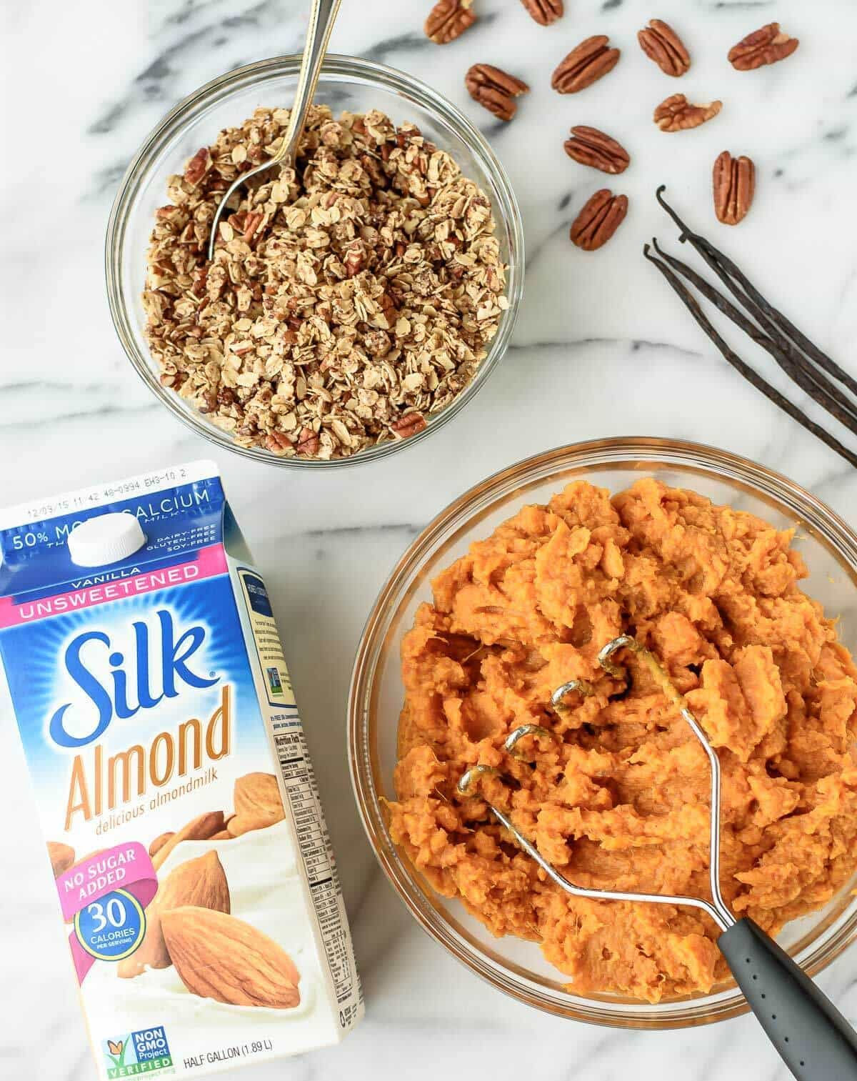Healthy Sweet Potato Casserole made with coconut oil, vanilla beans, and maple syrup. Vegan, gluten free, and dairy free, this dish is perfect for guests with dietary restrictions, but everyone else will love it too!