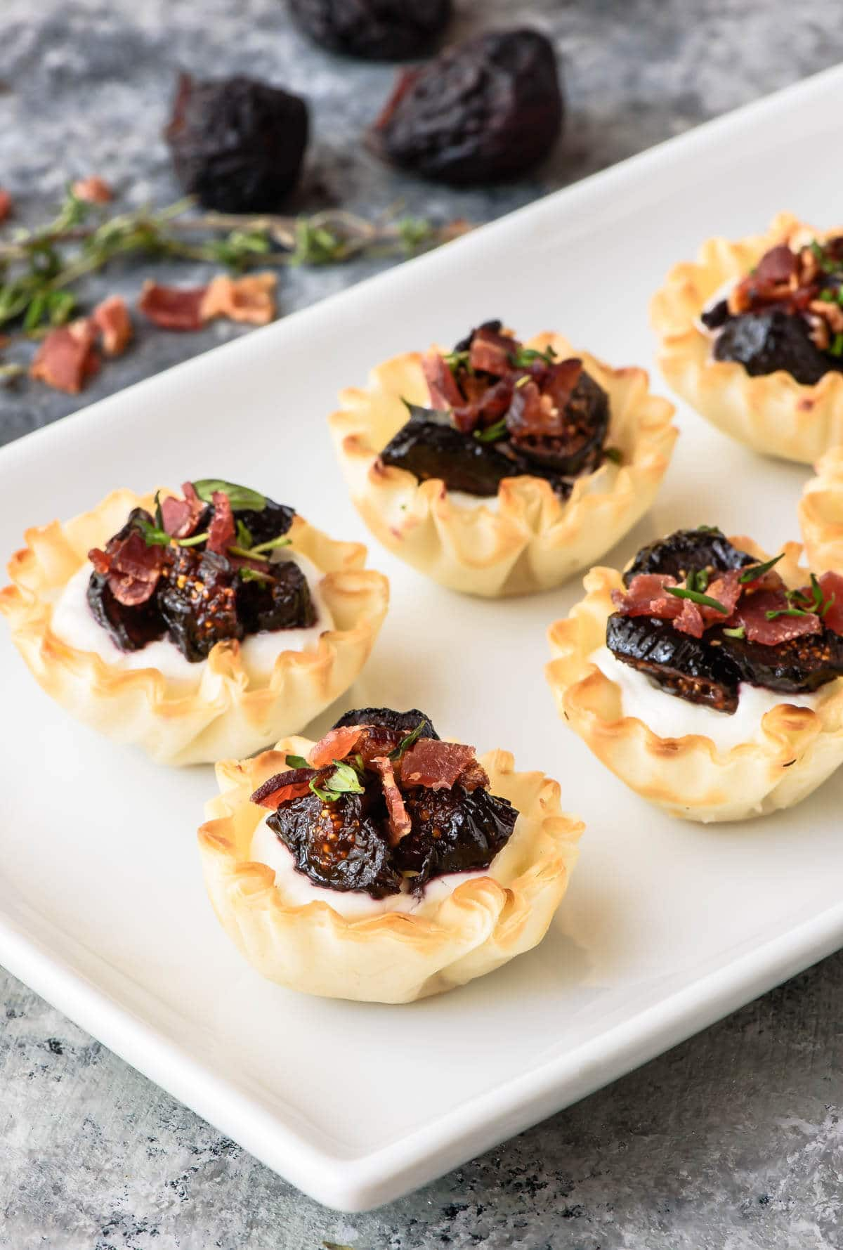 Easy Mini Fig Goat Cheese Bacon Bites in Phyllo Dough. Premade phyllo dough cups make this the easiest but most impressive appetizer recipe!