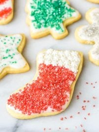 The BEST Cut Out Sugar Cookies from scratch with no-fail icing. A foolproof Christmas cookie recipe that even kids can make!