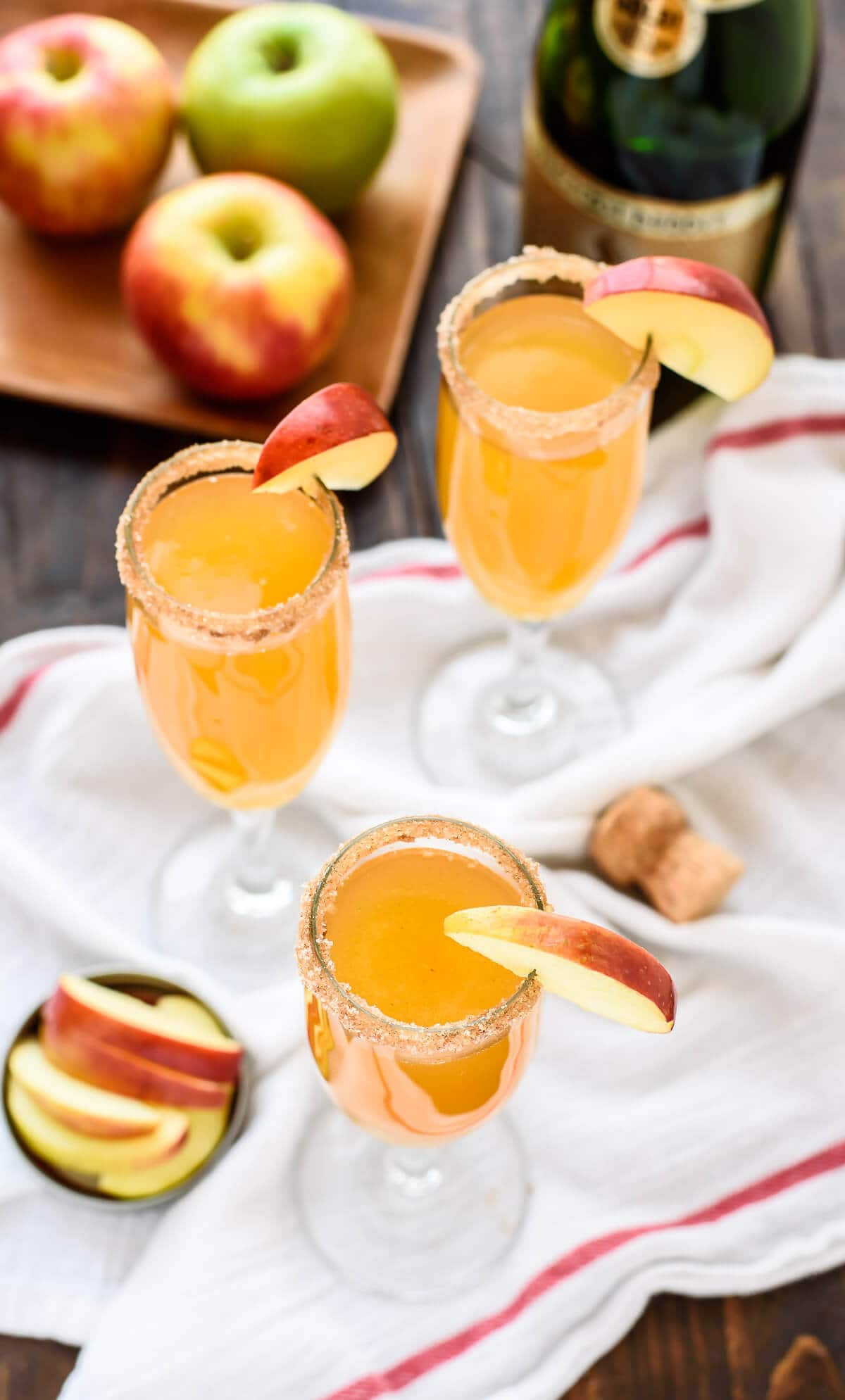 With only 3 ingredients, this beautiful and delicious Apple Cider Champagne Cocktail recipe will become your signature drink!
