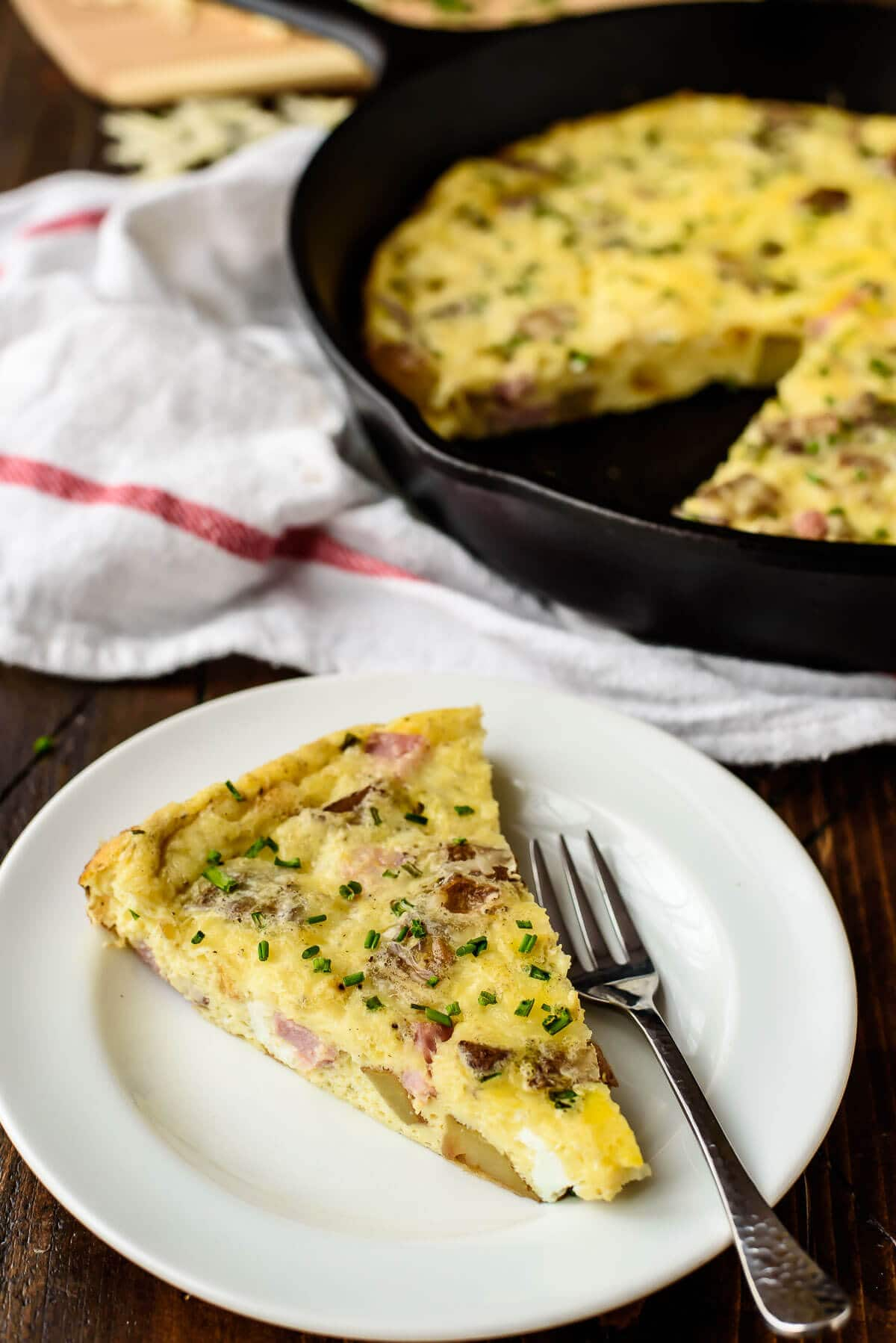Baked Cheesy Ham Potato Frittata. Perfect for a weekend brunch or busy school night dinner.