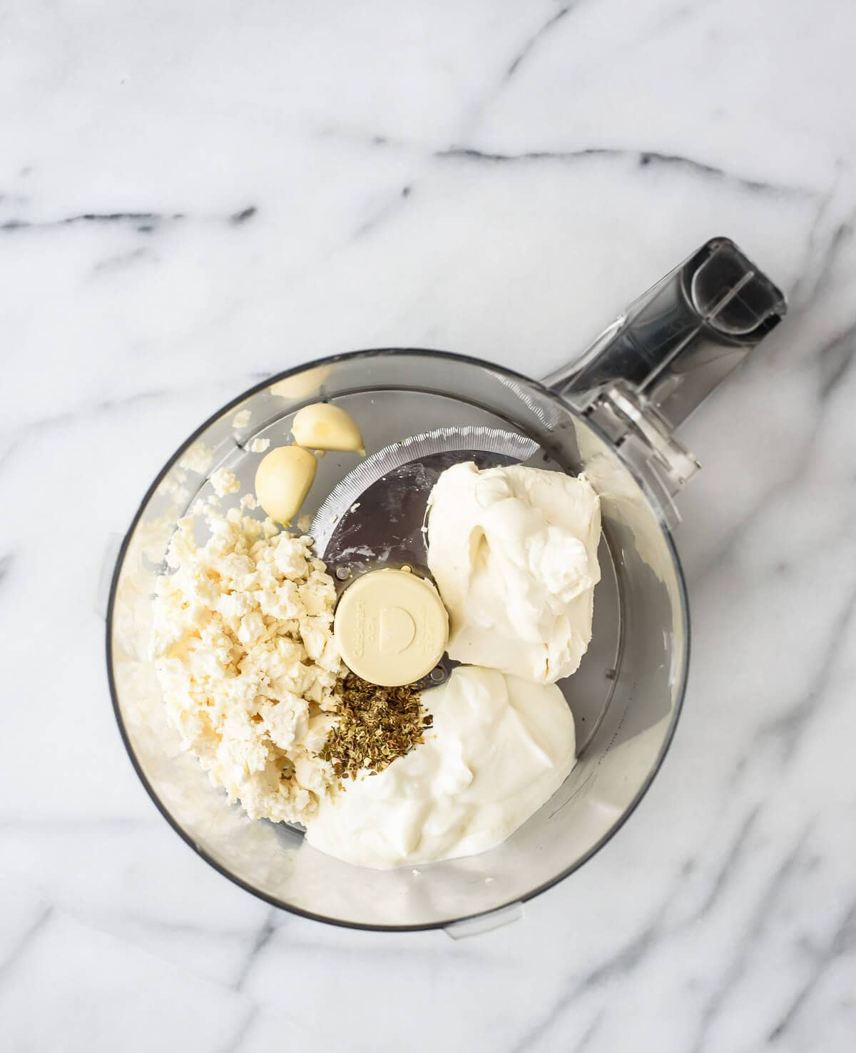Skinny Garlic Feta Dip made with Greek yogurt. Easy and so delicious!