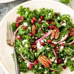 Make ahead Kale Salad with Pomegranate and Pecans. Our favorite winter salad recipe!