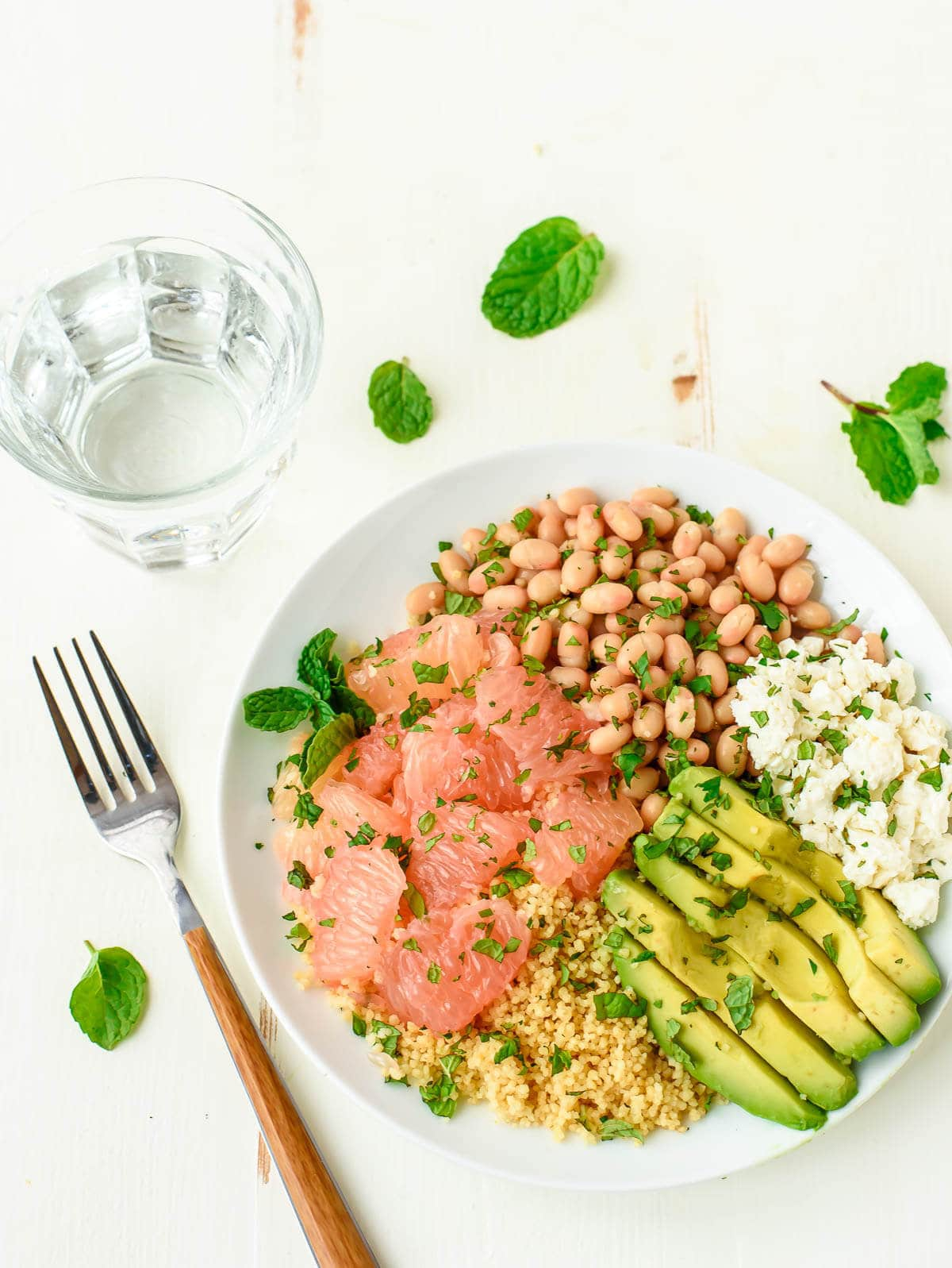 Avocado Grapefruit Couscous Salad with Feta and White Beans. A beautiful, healthy salad that's perfect for a side or light lunch.