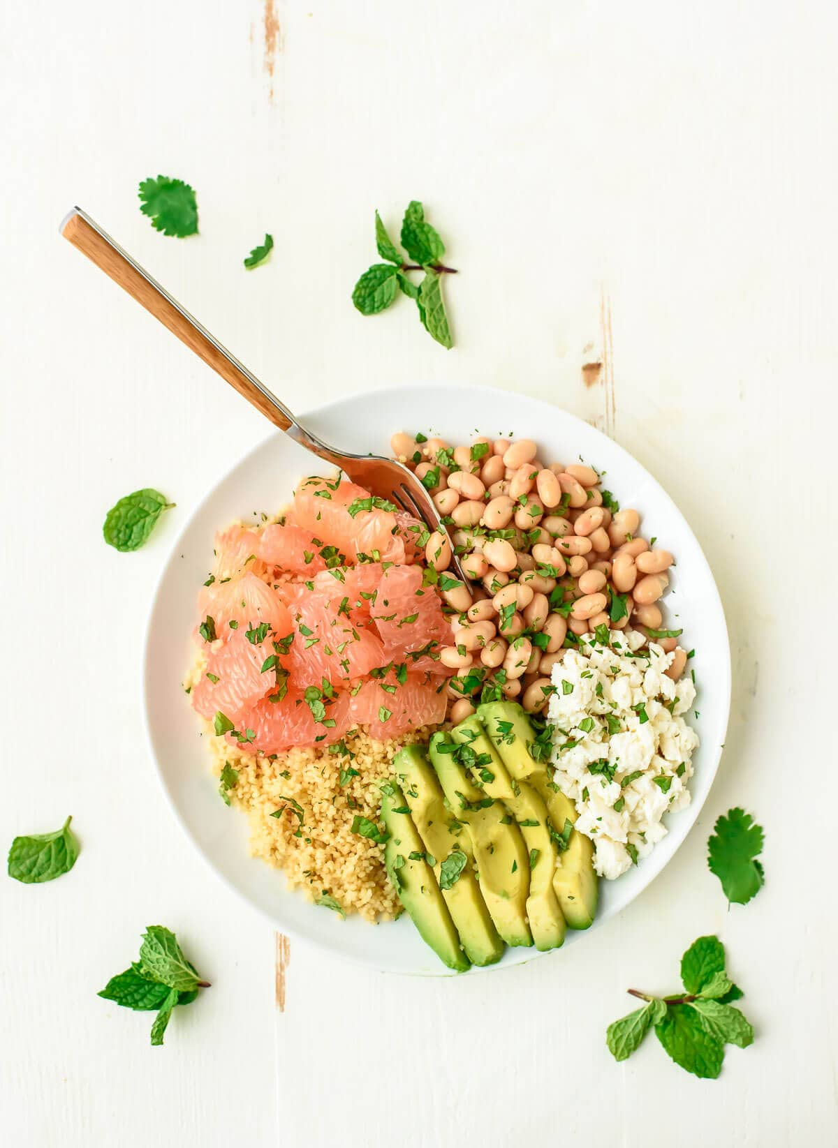 Avocado Couscous Grapefruit Salad with White Beans. A healthy, filling salad recipe that's easy to make and perfect for a light lunch or side.