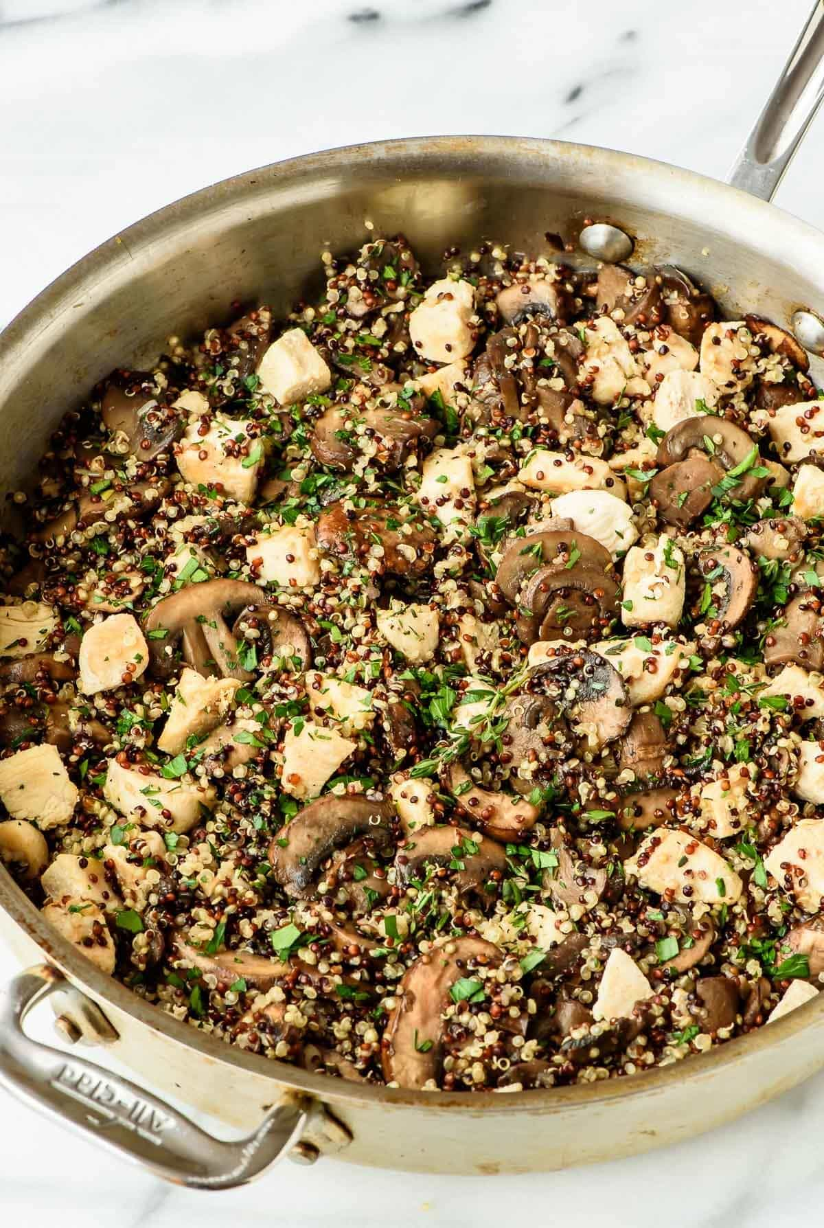 Skillet Mushroom Chicken and Quinoa - This easy weeknight meal is light, healthy and will be a HUGE hit with your family! Ready in 30 minutes.