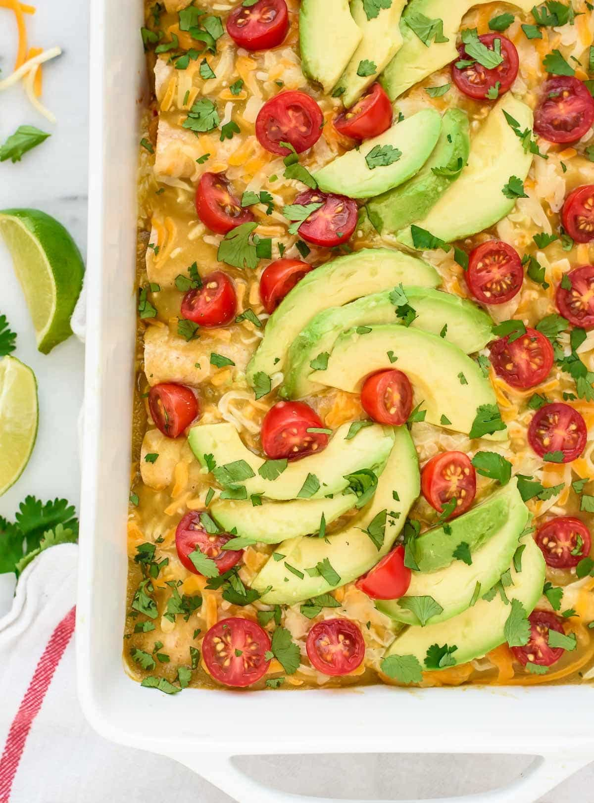 The BEST Green Chile Chicken Enchiladas. These are so creamy and cheesy, you'd never guess that they are healthy too!