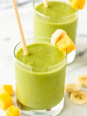 4 Ingredient Mango Green Smoothie — Tastes like a tropical vacation! Sweet, creamy, healthy and filled with vitamins. Kids love it too! {vegan, gluten free, and dairy free with no sugar added!}