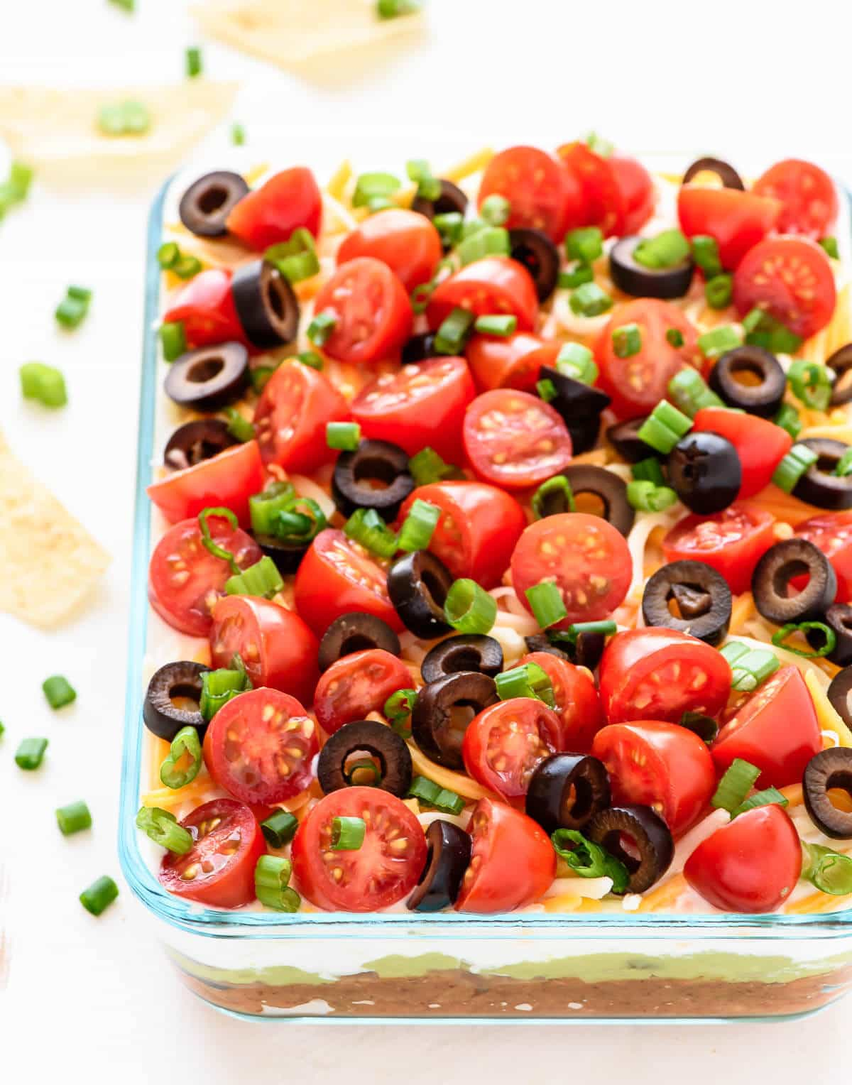 Bring this classic 7 Layer Taco Dip to your next party! Made with fresh ingredients, it's healthy but still tastes indulgent. Great for football, game watches or a potluck!