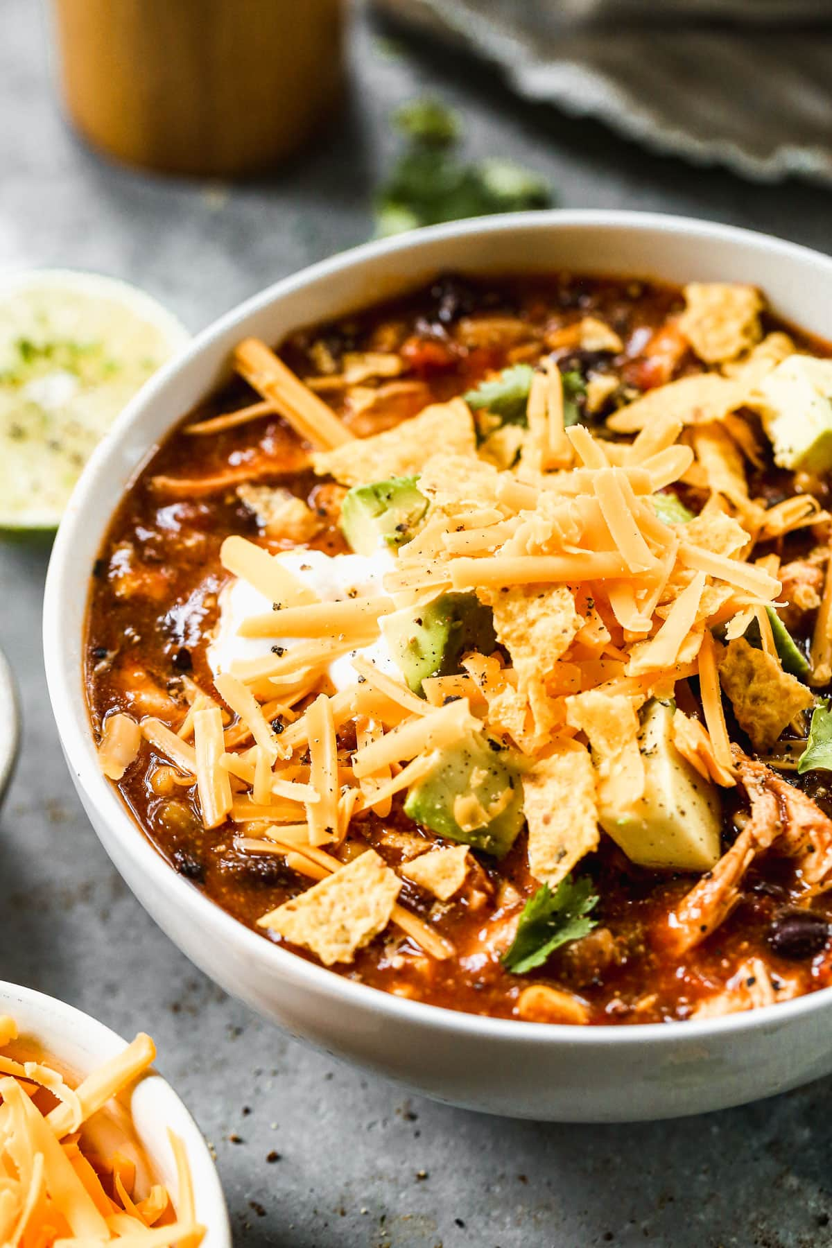 Easy, healthy slow cooker enchilada soup. Our entire family loves this recipe, and it only takes 10 minutes to prep!