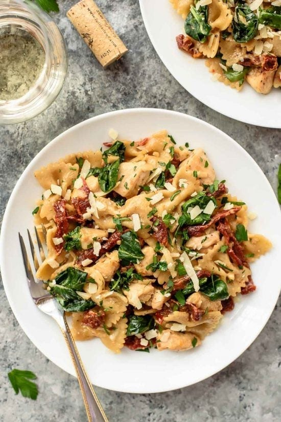 Creamy Sun Dried Tomato Chicken Pasta. Easy and SO GOOD. A romantic dinner recipe that's ready to go in 20 minutes!
