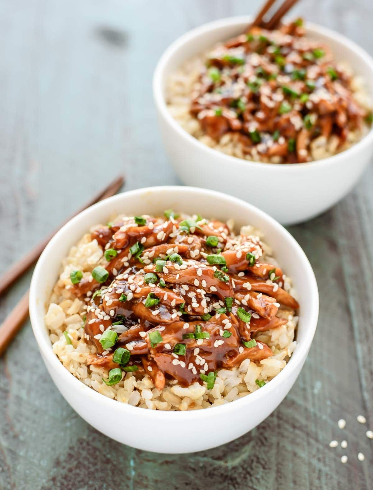 bowls of Asian chicken teriyaki served over rice