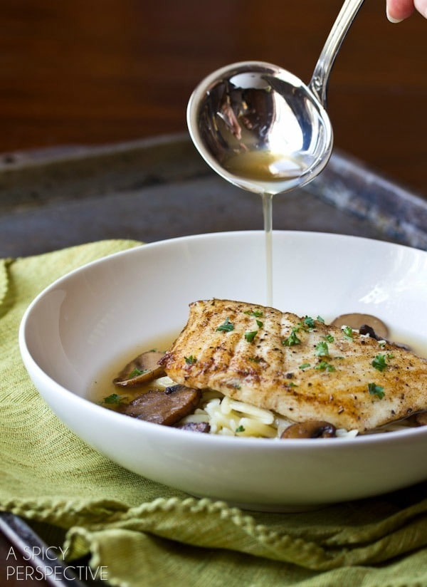 Mushroom Broth Brown Butter Seared Halibut. This is one romantic date night dinner recipe you won't soon forget!