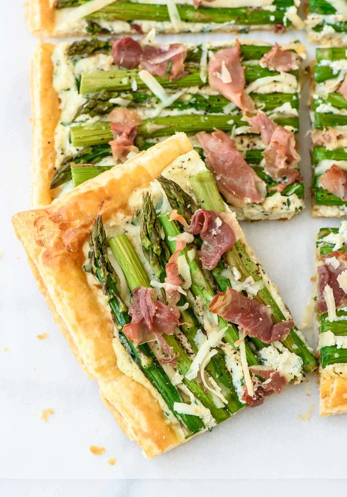 This GORGEOUS and EASY Asparagus Tart is made with puff pastry for an instant shortcut. Buttery crust, creamy ricotta, salty prosciutto. You HAVE to make this recipe! @wellplated