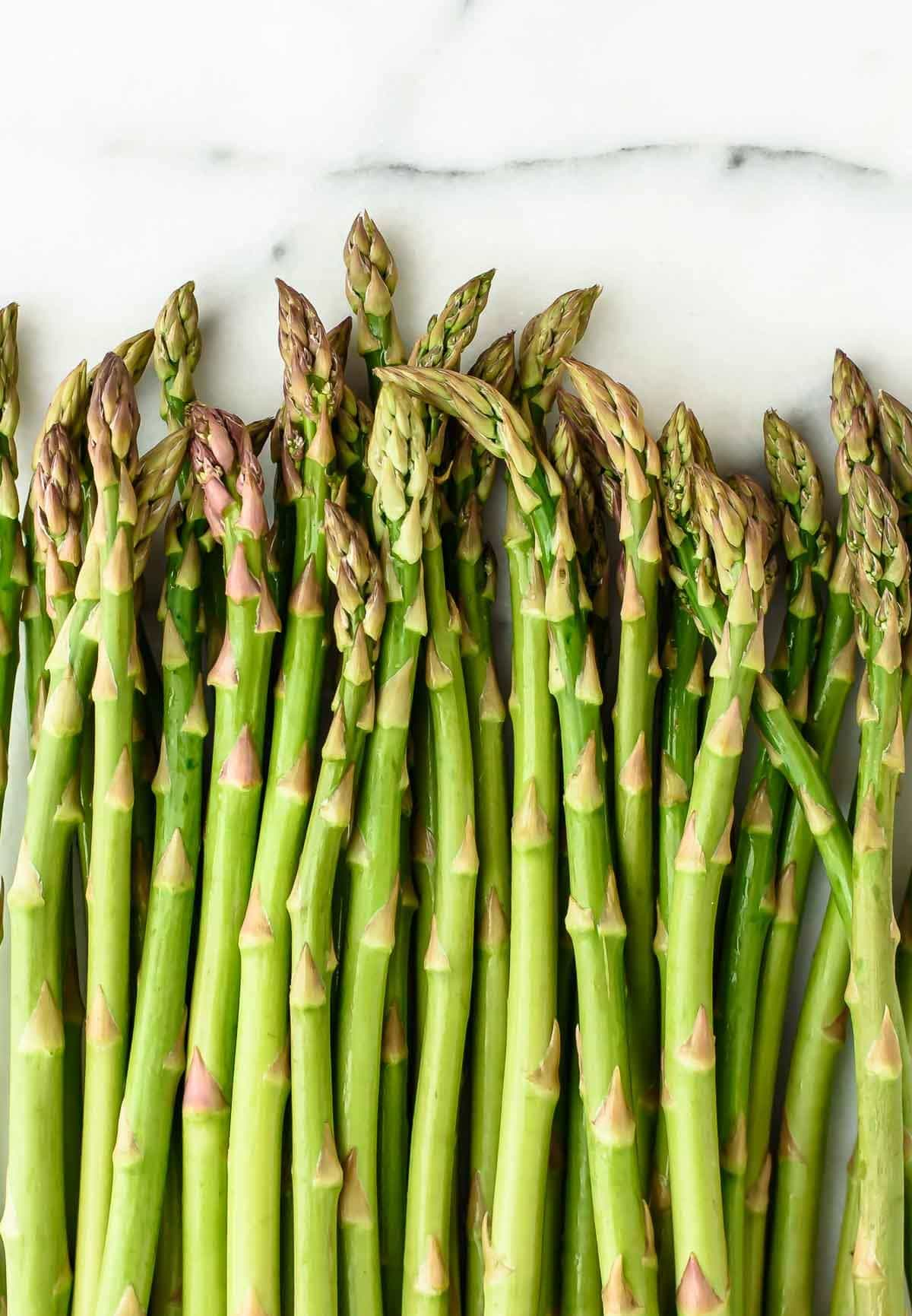 An easy Asparagus Tart with Puff Pastry and ricotta. A delicious appetizer or main dish! @wellplated