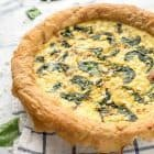 Phyllo dough crust is the secret to making this impressive Spinach Feta Quiche. Perfect for a Sunday brunch! @wellplated