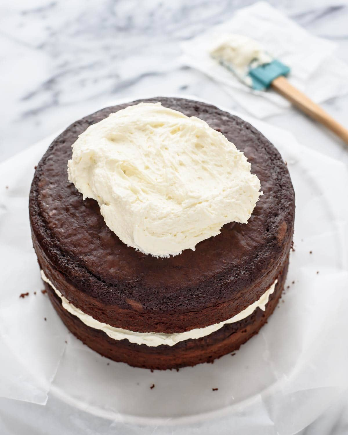 Triple Chocolate Cake with White Chocolate Buttercream. This is a MUST for all chocolate lovers! @wellplated