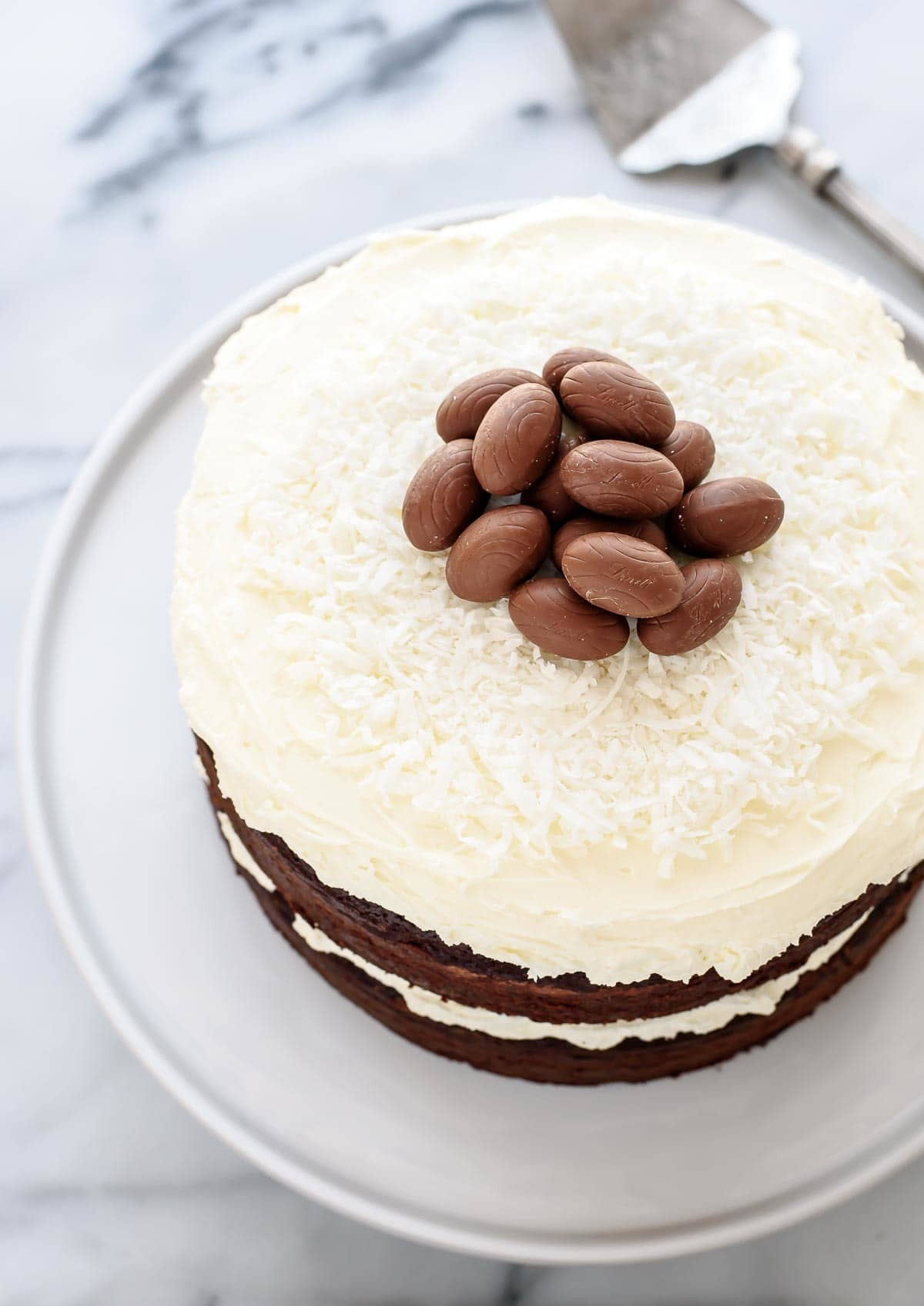 This recipe is INCREDIBLE. Triple Chocolate Easter Cake. A homemade chocolate cake with THREE kinds of chocolate, topped with chocolate Easter eggs. Perfect Easter dessert to wow your guests! @wellplated