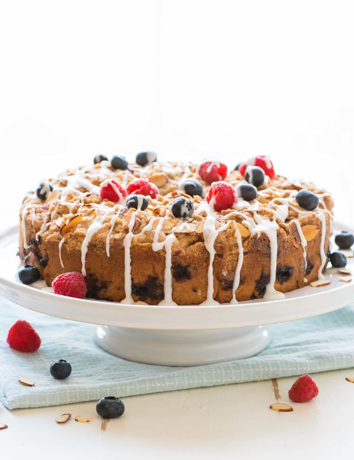 Almond Berry Crumb Cake recipe – this is the BEST coffee cake! It has tons of buttery cinnamon crumbs, the cake is soft and moist, and every bite has berries. Perfect for brunch! @wellplated