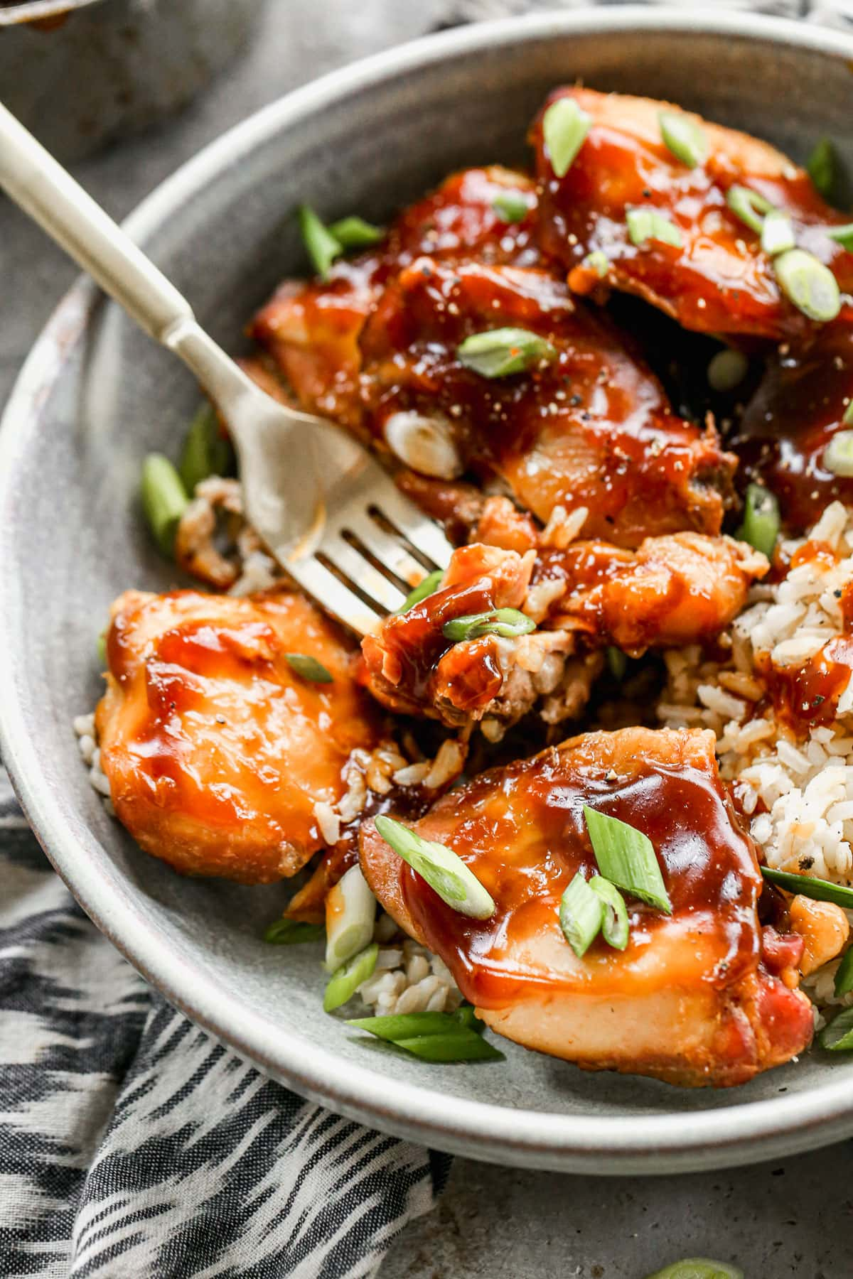 Crock Pot Bourbon Chicken recipe — so easy to make, and the sauce is sweet, sticky, and delicious! Our whole family loves it. Perfect slow cooker recipe to serve with rice for weeknight dinner. @wellplated